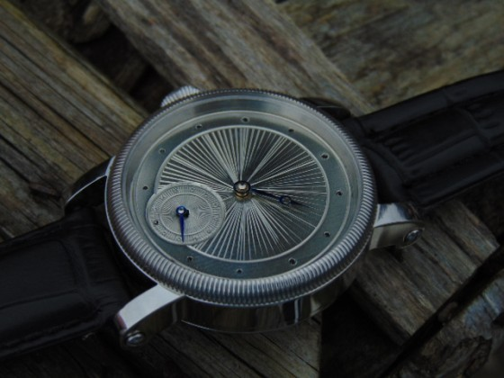 Hand guilloche dial watch.